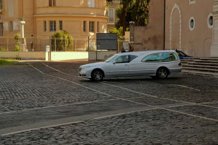 hearse: Rome, Italy - August 17, 2015: Hearse near entrance to Basilica di Santa Croce in Gerusalemme in shadow of morning sun Editorial