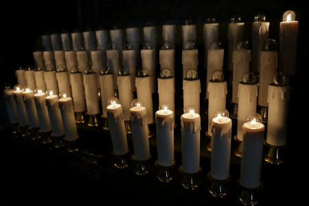 incandescent: Rome, Italy. Electrical candles with incandescent lamps in basilica