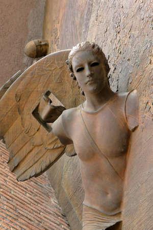 martiri: Rome, Italy - August 17, 2015: Detail of angel from gate of basilica Santa Maria degli Angeli e dei Martiri by sculptor Igor Mitoraj Editorial
