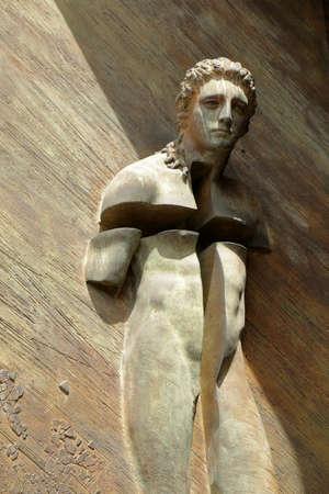 martiri: Rome, Italy - August 17, 2015: Detail from gate of Basilica di Santa Maria degli Angeli e dei Martiri. Symbol of martyr by sculptor Igor Mitoraj