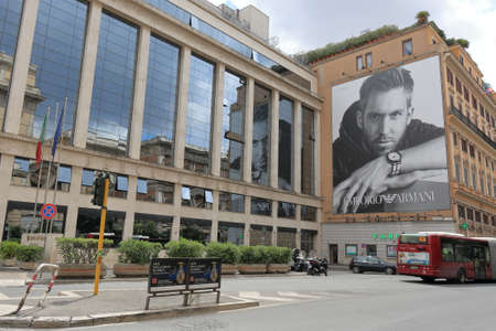 stopped: Rome, Italy - August 17, 2015: View of building at crossroads Via Venti Settembre and Via Pastrengo with poster of Emporio Armani Editorial