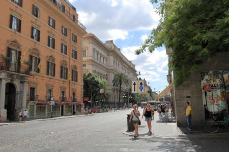 nationale: Rome, Italy - August 17, 2015: Two girls crossing the street at a pedestrian crossing Via Nationale and Via Parma