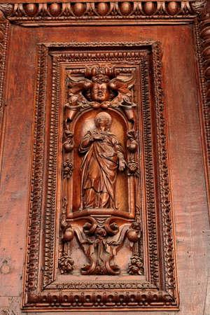 martiri: Rome, Italy - August 17, 2015: Detail of the entrance door in Parrocchia Santi Vitale e Compagni Martiri in Fovea by address Via Nazionale, 194B Editorial