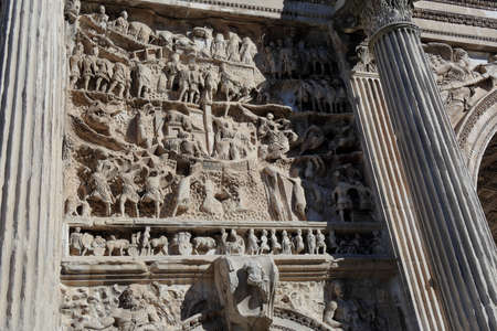 severus: Carved in stone figures of wall of Septimius Severus Arch in Rome, Italy Stock Photo