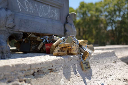 frendship: Rome, Italy - August 18, 2015: Bunch of padlocks of lovers on the bridge in Rome. Small depth of field Editorial