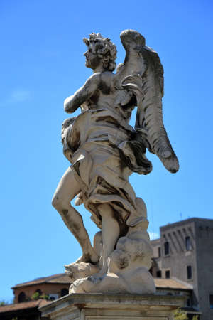 brige: Angel with the Superscription Regnavit a ligno deus in brige Ponte SantAngelo in Rome, Italy. Side view. Sculptor Gian Lorenzo Bernini and son Paolo. Stock Photo