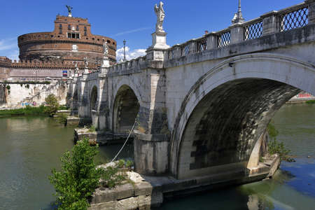 brige: Rome, Italy - August 18, 2015: Castel SantAngelo and brige Ponte SantAngelo in sunny day against clear blue sky Editorial