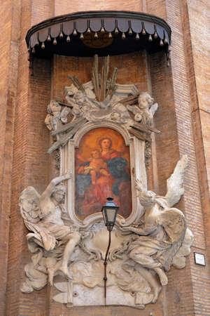 angel roses: Icon with Virgin Mary and Jesus Christs image at the corner of a wall of Catholic church Congregazione DellOratorio di San Filippo Neri. Rome, Italy