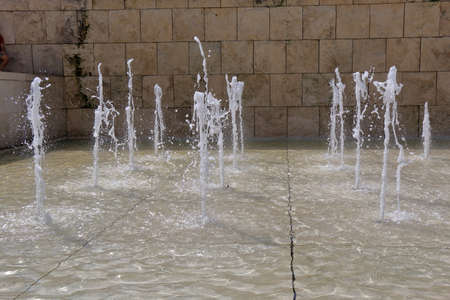 purity: Vertical Jets of water in fountain in summer day Stock Photo