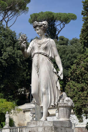 abundance: Sculpture Goddess of Abundance in form a woman with basket with fruit in Piazza del Popolo in Rome, Italy.
