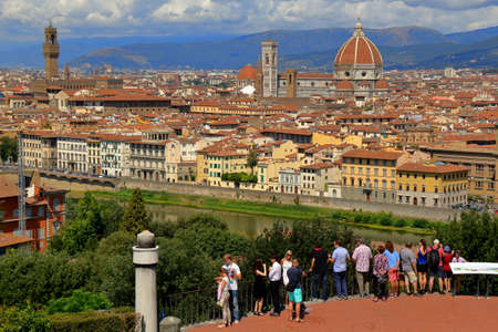 michelangelo: Florence, Italy - August 19, 2015: Tourists watching from the observation deck near the Piazzale Michelangelo on the city of Florence.