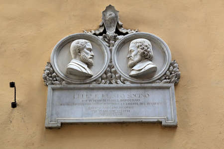 humanist: Siena, Italy - August 20, 2015: Plaque in honor of Lelio and Fausto Sozzini in Siena. Lelio Francesco Maria Sozzini or simply Lelio january 29, 1525-May 4, 1562 was an Italian humanist and Reformer. Fausto Sozzini December 5, 1539 - March 4, 1604 was an I
