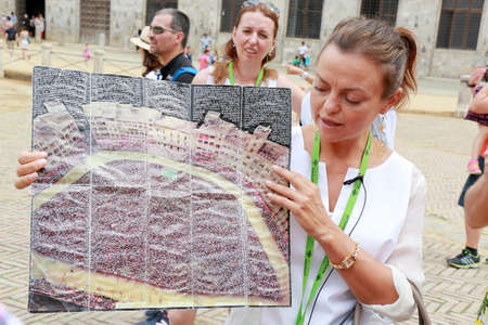 palio: Siena, Italy - August 20, 2015: The guide Irina tells tourists about the Palio di Siena horse race that is held twice each year