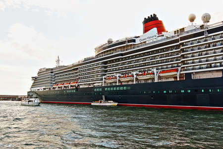 ms: Venice, Italy - August 21, 2015: Cruise Ship MS Queen Victoria and boats in Venice Editorial