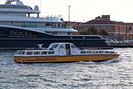 ve: Venice, Italy - August 21, 2015: Boat Sior Elio Alilaguna VE 8885 float by sea in the morning. Editorial