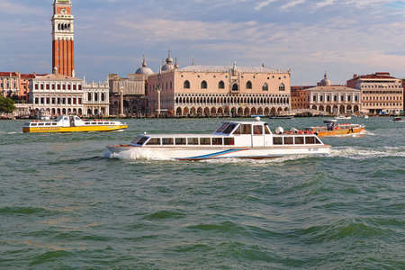 ducale: Venice, Italy - August 21, 2015: View of the Palazzo Ducale and motor boats with passengers in canal in the morning Editorial