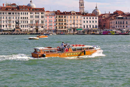 ve: Venice, Italy - August 21, 2015: Wooden motor boat Cadama Ostro with number VE 9425 in Venetian Canal Editorial