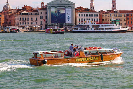 ve: Venice, Italy - August 21, 2015: Wooden motor boat Cadama Ostro with number VE 9425 in Grand Canal Editorial