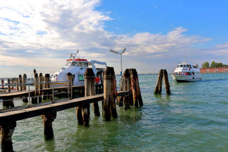 berth: Venice, Italy - August 21, 2015: Arrival to berth a motor boat with passengers in the morning