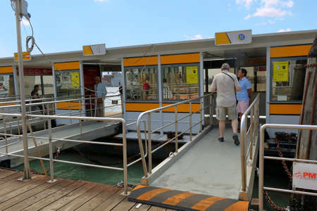 waterbus: Venice, Italy - August 21, 2015: People await the arrival of the waterbus at the stop
