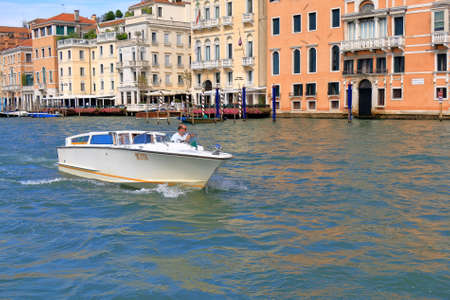 ve: Venice, Italy - August 21, 2015: White motor boat taxi VE 8770 in the Grand canal in Venice. Editorial