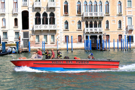 institutional: Venice, Italy - August 21, 2015: Motor boat Vigili del Fuoco in Grand Canal. Official name Corpo nazionale dei vigili del fuoco, is Italys institutional agency for fire and rescue service.