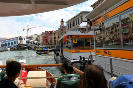 waterbus: Venice, Italy - August 21, 2015: View from aboard a vaporetto to the Rialto Bridge and waterbus stop
