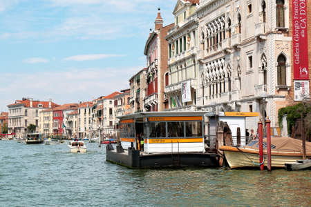 Venice, Italy - August 21, 2015: Motorboats and waterbus stop CaDOro in the Grand Canal