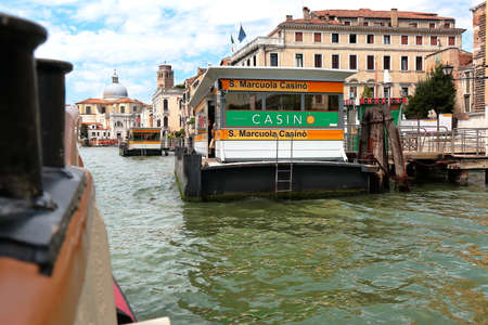 waterbus: Venice, Italy - August 21, 2015: View from the arriving vaporetto to the waterbus stop S. Marcuola Casino in Grand Canal Editorial