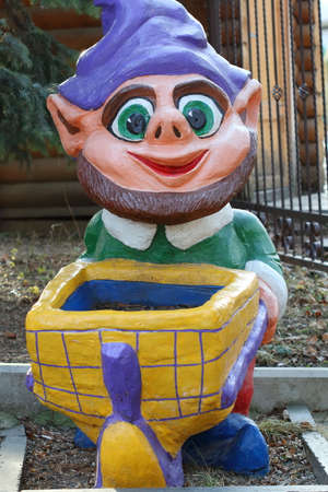 pushcart: Pyatigorsk, Russia - December 12, 2015: Sculpture is a cheerful gnome with a pushcart in a City Park