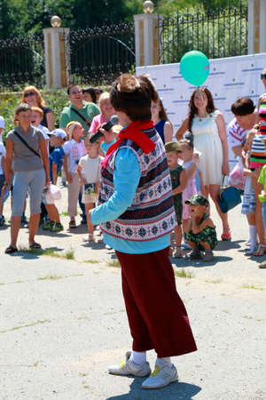 entertain: Kislovodsk, Russia - July 18, 2015: Animators in front of the entrance to the circus entertain the people