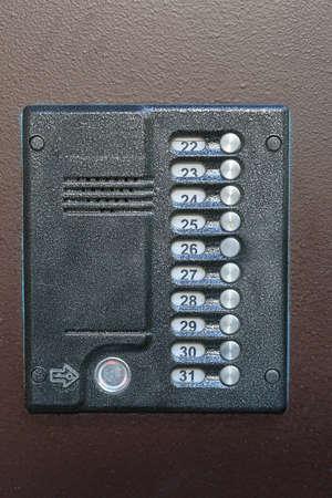 intercom: Old intercom (doorphone) in brown door Stock Photo