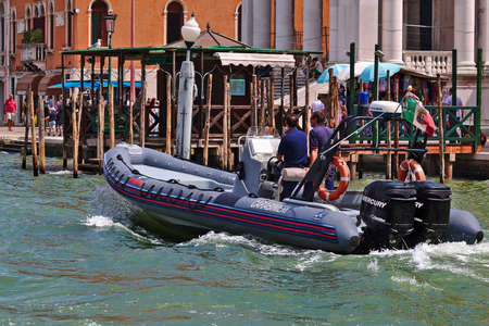onboard: Venice, Italy - August 21, 2015: Carabinieri Motorboat national military police of Italy with two men onboard