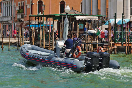 motor cop: Venice, Italy - August 21, 2015: Carabinieri Motorboat national military police of Italy with two men onboard