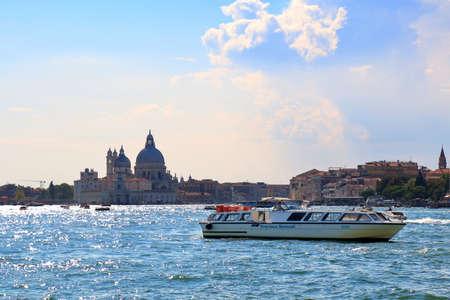 IGLESIA: Venice, Italy - August 21, 2015: View to Basilica di Santa Maria della Salute from Venetian Lagoon at evening