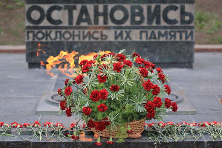 a memorial to fallen soldiers: Pyatigorsk, Russia - April 1, 2017: Basket with flowers. Memorial Eternal Flame to the fallen soldiers during the Great Patriotic War in Pyatigorsk. Stavropol Region Editorial