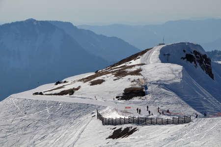 A group of tourists skiing in the ski resort Rosa Khutor. Sochi, Krasnaya Polyana, Krasnodar Territory, Russia