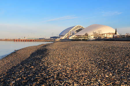 Olympic Stadium Fisht at dawn and view from the shore of the Black Sea Editorial