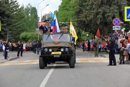 pyatigorsk: Pyatigorsk, Russia - May 9, 2017: UAZ car with war veterans on a Parade dedicated to the Victory in the WWII. Editorial