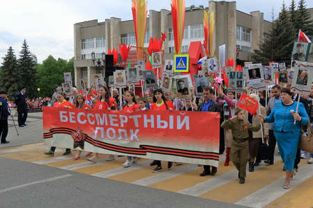 Pyatigorsk, Russia - May 9, 2017: Column Immortal Regiment. People took to the street in Pyatigorsk with portraits of their ancestors who fought in World War II. Celebration of the Victory Day