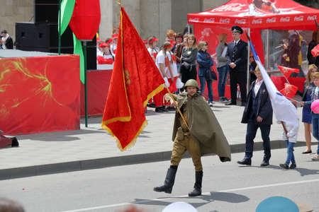 soviet flag: Pyatigorsk, Russia - May 9, 2017: Standard bearers carry flags on the Victory Day Parade in Pyatigorsk Editorial