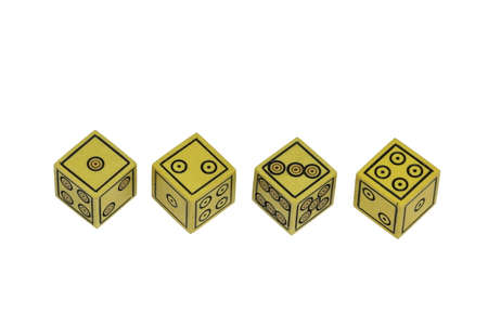 ivories: Four small old yellow handmade dices in a row isolated on white background Stock Photo