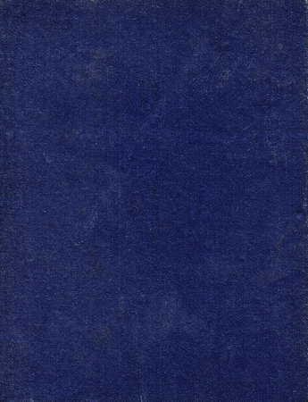 The dirty and scratched old dark blue book cover. Abstract background Imagens