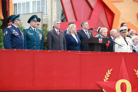 Pyatigorsk, Russia - May 9, 2018: Veterans and mayor of Pyatigorsk Andrey Skripnik on the platform during the festive parade on the Victory Day in the Great Patriotic War