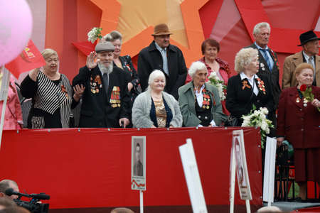 Pyatigorsk, Russia - May 9, 2018: Platform with veterans of the Second World War. Celebration of the Victory Day in Russia. Near the veterans passes participants of the march Immortal Regiment Editorial