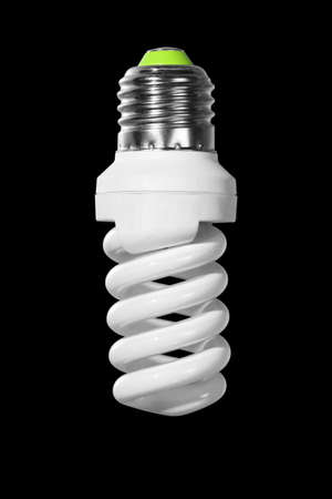Switched off compact fluorescent Lamp with spiral tube isolated on a black background Banco de Imagens