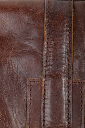 Stitched brown leather parts. Details of a man's bag. Abstract background Stock Photo - 104397539