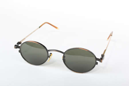 a4611f5c63e Old scratched sunglasses with metal frame in steampunk style on a white  background Stock Photo