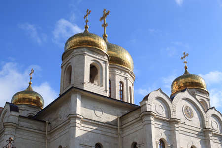 The Bell tower and golden domes with crosses. The Cathedral of Christ the Savior (Savior Cathedral) in Pyatigorsk, Russia