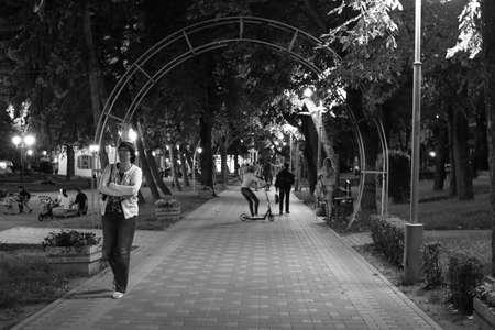 Pyatigorsk, Russia - August 13, 2018: Unknown people walk through the night Tsvetnik Park in Pyatigorsk resort town. Noisy image 報道画像